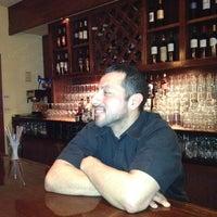 Photo taken at Bistro Mediterranean & Tapas Bar by Jennifer H. on 2/8/2012