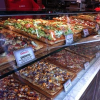 Photo taken at Carluccio's Coal Fired Pizza by Alison C. on 7/11/2012