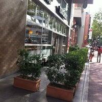 Photo taken at Tsutaya Book Store Tenjin by Kazuya K. on 7/9/2012