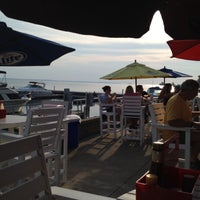 Photo taken at Dockers Waterfront Restaurant & Bar by Heather M. on 8/8/2012