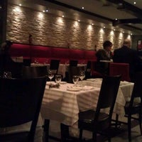 Photo taken at Momento Restaurant Bistro by Stace on 11/24/2011
