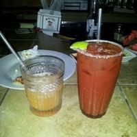 Photo taken at Iguana Wanna Bar & Grill by Portia M. on 8/21/2011