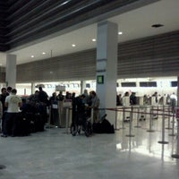 Photo taken at International Departures by the cage m. on 4/17/2012