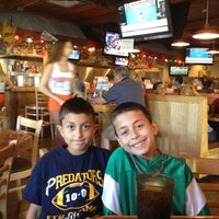 Photo taken at Hooters by Brandy M. on 12/18/2011