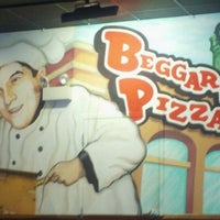Photo taken at Beggars Pizza by Josh H. on 11/19/2011