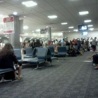 Photo taken at Concourse A by Joey L. on 7/7/2012