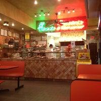 Photo taken at La Strada Pizzeria & Restaurant by Nat P. on 12/10/2011