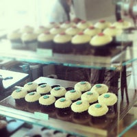 Photo taken at Crave Cupcakes by Anastasia K. on 6/8/2012