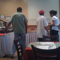 Photo taken at Sangam Indian Restaurant by Marco C. on 8/4/2011