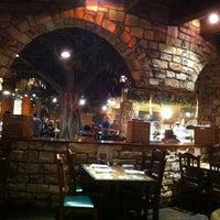Photo taken at Cinzzetti's Italian Market Restaurant by Mark W. on 8/9/2011