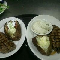 Photo taken at Texas Steakhouse & Saloon by Jasmine D. on 9/22/2011