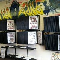 Photo taken at Tattoo Zone by Heathyr S. on 7/28/2012