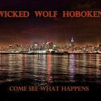 Photo taken at Wicked Wolf Tavern by Jon M. on 5/6/2011