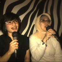 Photo taken at Fun Oke Karaoke BTM by Dina Yudianthy on 7/9/2012
