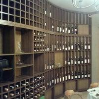 Photo taken at Carpe Diem Wine Shop & Bar by Alexander M. on 6/17/2011