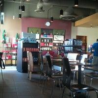 Photo taken at Starbucks by Lorenza D. on 11/15/2011