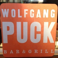 Photo taken at Wolfgang Puck Bar & Grill by Cheryl K. on 7/24/2012