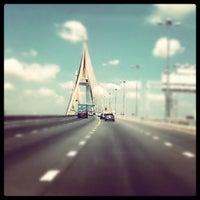 Photo taken at Bhumibol 1 Bridge by Yvonne T. on 3/8/2012