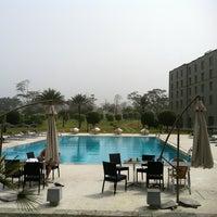 Photo taken at Hilton Malabo by Ermesto C. on 12/15/2011
