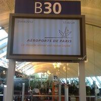 Photo taken at Terminal 2B by John A. on 4/25/2012