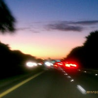 Photo taken at Glades Rd. & Powerline Rd. by Flutterby M. on 12/22/2011
