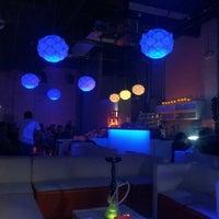 Photo taken at Tangerine Hookah Lounge by Miten P. on 7/15/2012