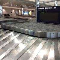 Photo taken at Baggage Claim by Dee S. on 6/19/2012