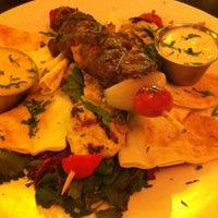 Photo taken at Olives Restaurant by Jon T. on 1/24/2012