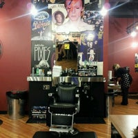 Photo taken at Floyd's 99 Barber Shop by Jessie M. on 10/28/2011