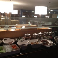 Photo taken at Delta Sky Club by Fabrice L. on 11/23/2011