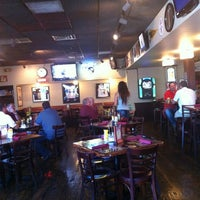Photo taken at Harpo's Bar and Grill by Dan J. on 7/17/2012