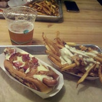 Photo taken at Bark Hot Dogs by Kadugen on 2/25/2012