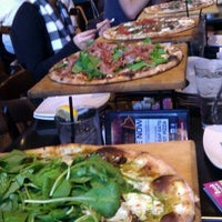 Photo taken at Urban Crust Wood Fired Pizza by Winnie N. on 12/27/2011