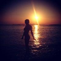 Photo taken at Ακτή του Ήλιου by Lena 🍃 M. on 8/24/2012