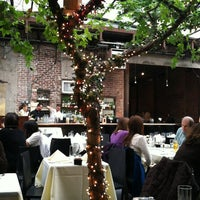 Photo taken at Revel Restaurant and Garden by Allison K. on 1/29/2012