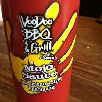 Photo taken at VooDoo BBQ & Grill Uptown by Lindsay J. on 12/5/2011