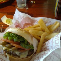 Photo taken at Red Robin Gourmet Burgers by Tarif Q. on 7/10/2012