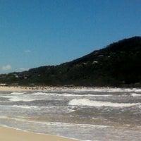 Photo taken at Praia da Ferrugem by Mileny M. on 1/14/2012