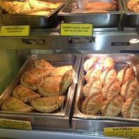 Photo taken at Julia's Empanadas by Warren W. on 8/10/2012