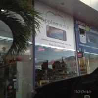 Photo taken at Applemania by Luana S. on 3/2/2012