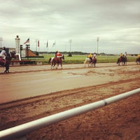 Photo taken at Lone Star Park by Carmen G. on 4/15/2012