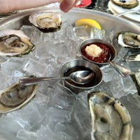 Photo taken at Oyster Club by Geoff S. on 8/6/2012