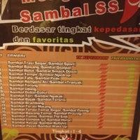 Photo taken at Waroeng SS (Spesial Sambal) by Dian N. on 2/27/2012