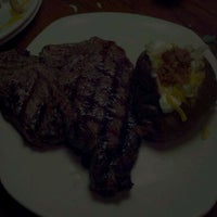 Photo taken at Outback Steakhouse by Ryan S. on 3/6/2012