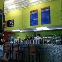 Photo taken at Pura Vida Cafe by Roberto A. on 7/8/2012