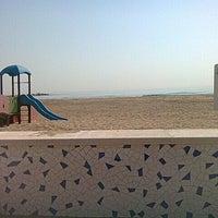 Photo taken at La Pobla de Farnals Beach by Ana R. on 4/19/2012