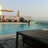 Photo taken at Hilton Dubai Roof Pool by Daniel K. on 9/1/2012