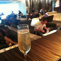 Photo taken at The Qantas Singapore Lounge by Liz F. on 6/3/2012