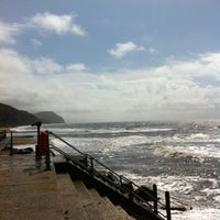 Photo taken at Charmouth Beach by Ant C. on 8/4/2012