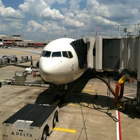 Photo taken at Gate T4 by Kevin S. on 7/23/2012